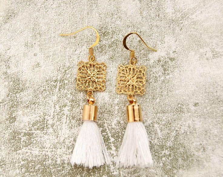 Gold & White Tassel Earrings by AbigailJewellery on Etsy https://www.etsy.com/listing/239739954/gold-white-tassel-earrings