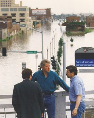The Great Flood of 1993. Davenport, Ia. President Bill Clinton, Gov. Terry Branstadt and Mayor Patrick Gibbs (back to camera) on the Centennial Bridge over the Mississippi River.