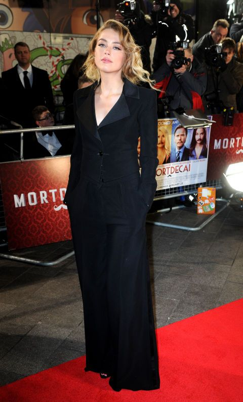 Amber Heard sports a sleek black suit at the London premiere of Mortdecai on January 19, 2015.