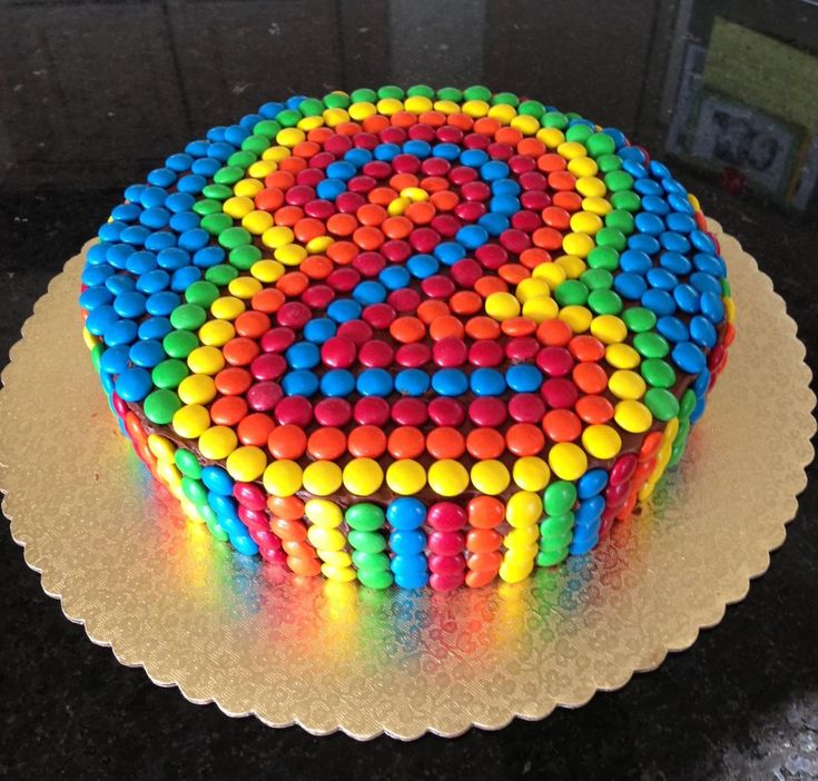 M&M cake - maybe use the minis and try this on a cupcake...