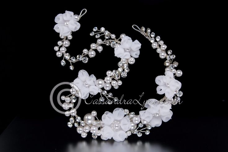 Soft organza flowers adorn this boho bridal hair vine of pearls and rhinestone sprays. It is flexible and has a salon style pinch clip and two loops for securing in your hair. It is 14 inches long and