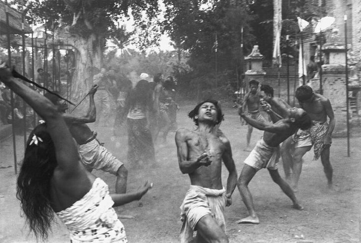 "INDONESIA. Bali. Village of Batubulan. Barong dance. 1949. The ""Kris dancers"" in a trance, they are doing the self-stabbing with kris, ngurek. From Magnum Photos."