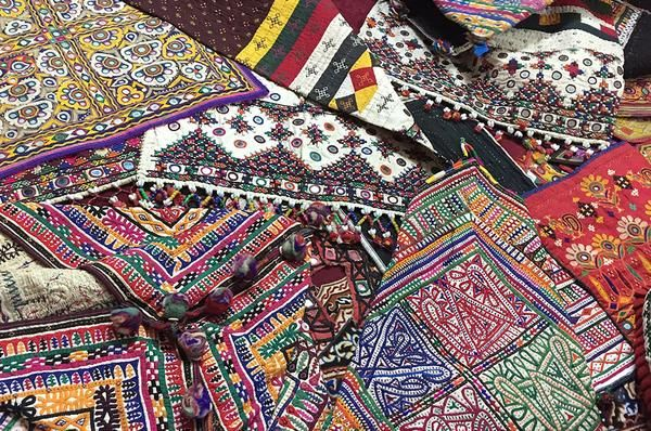 TraditionalIndianembroidery - KutchIntense and vivid color, intricate designs, finely embedded mirror work and exquisite stitching ....  These embroidered fabrics are imbibed with an artistic gravity we hadn't seen until our first v...