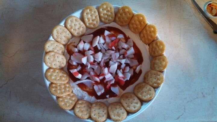 Crab dip:  cream cheese spread thin, cocktail sauce, crab or imitation, and crackers.