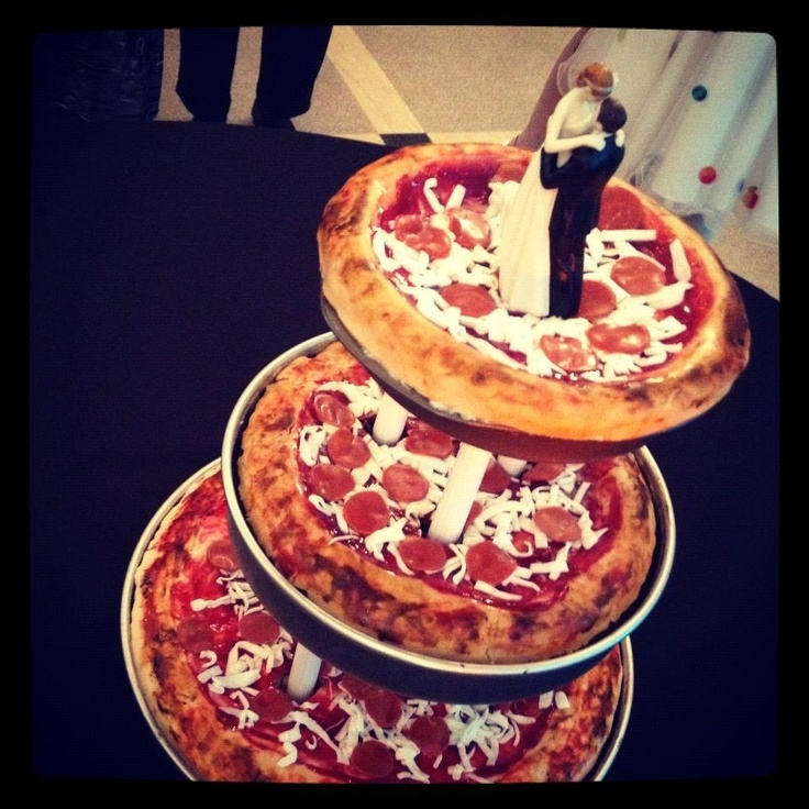 Pizza Wedding cake for my best friends wedding. It is actual cake covered with homemade marshmallow fondant colored and cut to resemble pepperoni and mozzarella cheese.