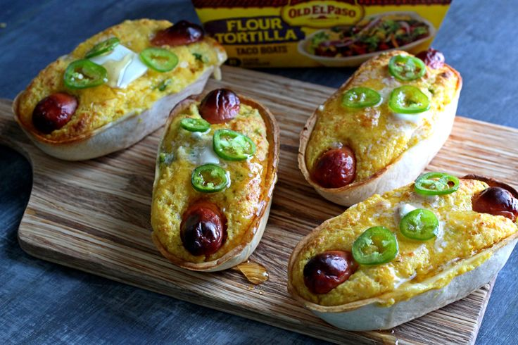 A soft taco boat filled with cheesy jalapeno corn muffin batter and a hot dog and baked into handheld corn dogs. Topped with butter and honey.
