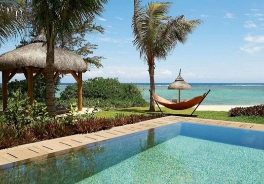 A romantic five-star, all-inclusive beach holiday at an eco-concious design base in mesmerising Mauritius, including all travel