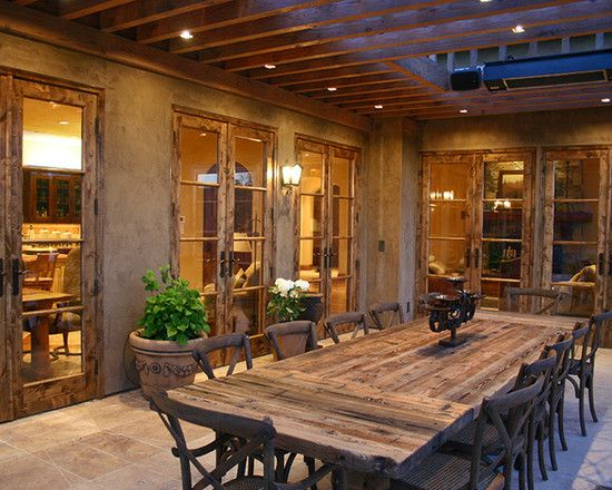 Mediterranean Classic Home Style That Attracts Your Attention: Rustic Patio  With Reclaimed Wood Dining Table