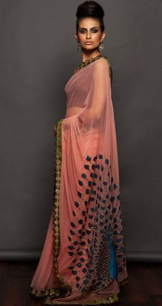 pink net saree features pita and resham work peacock on pallu and booti work detailling on border, comes with an in-cut sleveless blouse.  Rs 88,000
