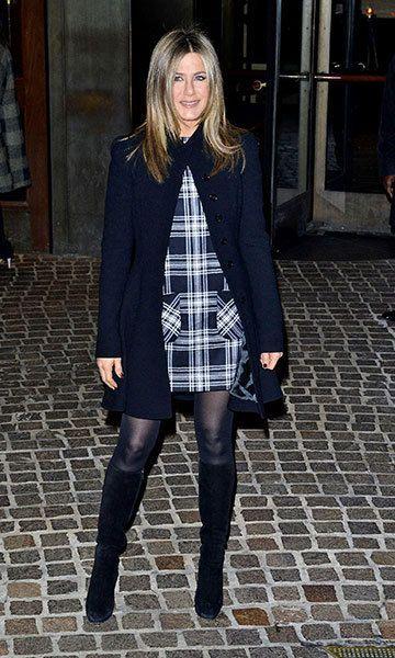 Jennifer Aniston cozies up to fiancé Justin Theraux in a plaid dress
