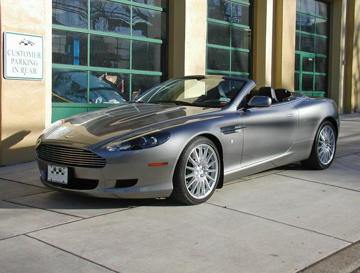 2006 Aston Martin DB9 Volante Hard to find 6-speed manual DB9 Volante with fewer than 3,000 miles! Tungsten Silver with Obsidian Black leather and Mahogany trim.  SOLD
