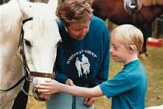 educatieve zorg boerderij geeft de kinderen met een beperking en oudere met een beperking een dag besteding.