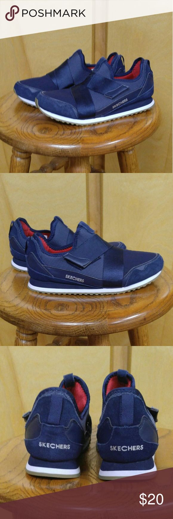 Navy Air Cooled Skechers Worn only once. No odor, non-smoker, no pets. Features stretch fabric front and collar panels for added comfort. Stretch satiny finish fabric criss-crossing instep straps. Fabric heel stripe overlay with pull on top tab. Embossed SKECHERS logo on side panel. Stretch fit collar and front. Soft fabric shoe lining. Air Cooled, Memory Foam cushioned comfort insole. Cushioned jogger-style comfort midsole. Flexible rubber jogger-style traction outsole. Size 7.5 M. Skechers…