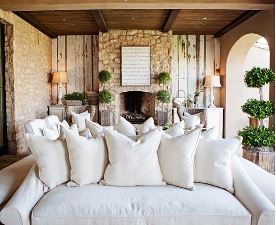 This lovely room casually put the barnwood along ONE accent wall.  Notice how the greenery breaks up all the monochromatic colors in the room. - Image courtest of Creative Juices Decor