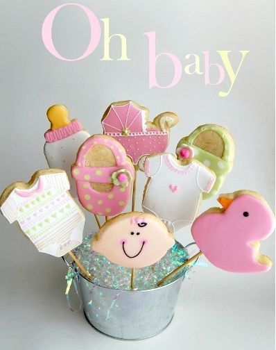 Baby Themed Cookies  If you bake (or have a friend who bakes), sugar cookies or cupcakes might be the way to go! You can make lots of sugar cookies in baby-themed shapes — like rattles, ducks, onesies, and more — using the help of cookie-cutters. Package the cookies in colorful cellophane bags and give them out as favors. Or better yet, put them on sticks and use them as decor as well! Guests can pick their cookies on the way out. #babyshowerfavors http://printmybabyshower.com/