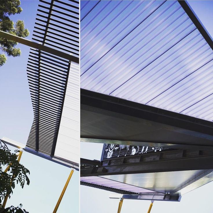 Rectangular polycarbonate roof panels are framed with galvanized steel beams.  An irregular layout of battens diffuses the view skyward replicating a trees canopy or cloud cover.  #perthzoo #chindarsiarchitects #thisiswa #perthisok #sustainabledesign #forecourt #shadestructure #solarpower #entrycanopy #corporatecolours #awardwinning