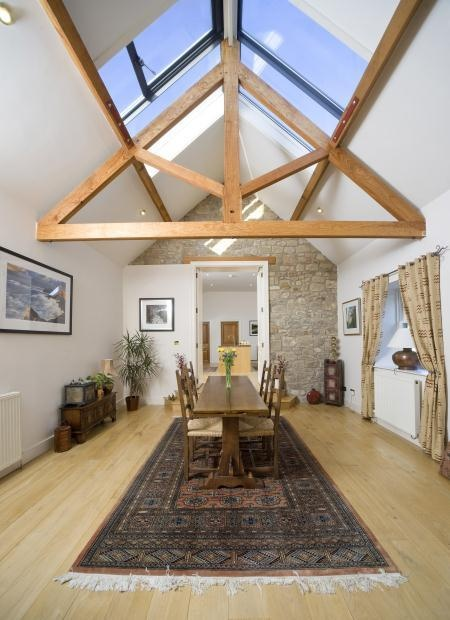 This magnificent barn conversion is a fantastic example of modern beams, creating a striking interior