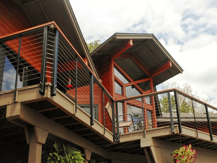 Aluminum railing on elevated residential deck. DesignRail® aluminum railing on elevated deck with 400 Cap Rail option and fascia mounting.