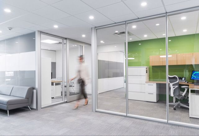 New Feature From Modern Home — Check out this modern office space, designed and installed by Monk Office using the Dirtt Wall System.