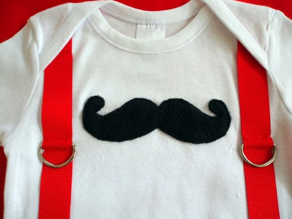 This cute onesie has a stylish black moustache and red suspenders.  Moustache Onesie by keb4kids on Etsy