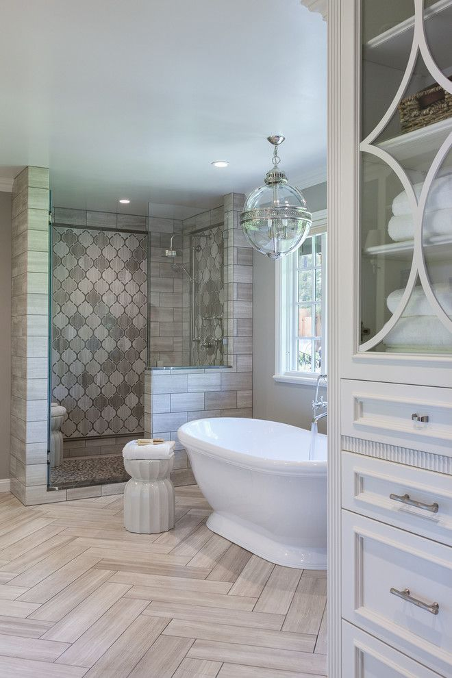 master bathroom with herringbone tile on floor freestanding tub and walk in shower artistic - Master Bathroom