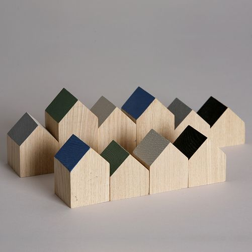 I just love little wooden houses. These would be sweet in a nursery.