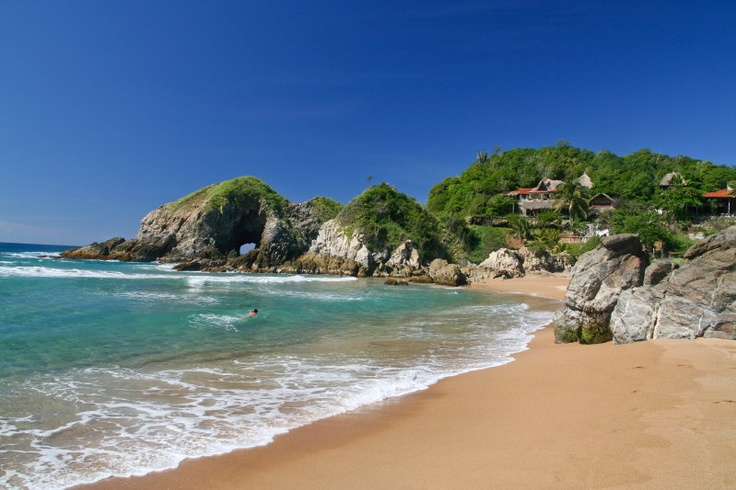Zipolite in Mexico. Go there!  Stayed here for a few weeks in a palapa.