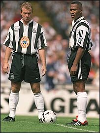 Alan Shearer (Newcastle United FC, 1996–2006, 303 apps, 148 goals) and Sir Les Ferdinand (Newcastle United FC)