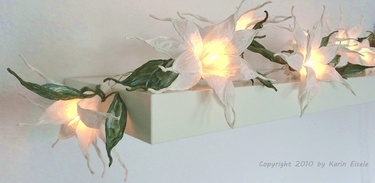 Paper flowers - light garland made by Paperilla.
