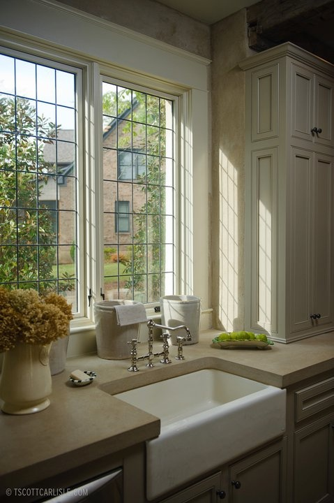 Gorgeous Kitchen with beautiful windows above the lovely sink by Christopher Architects