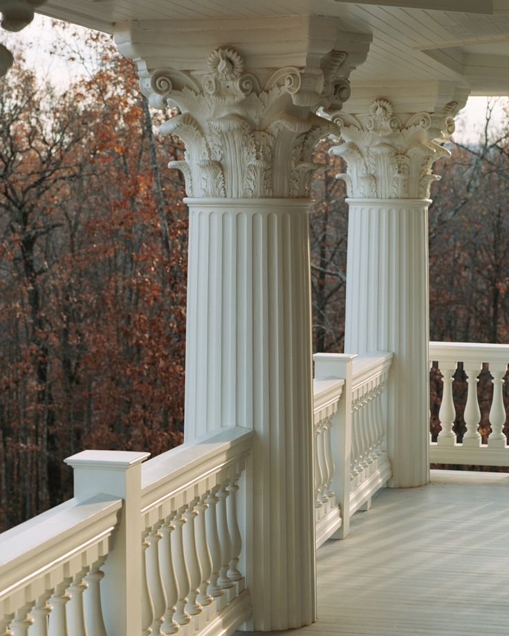 Porch with large round fluted columns with decorative caps