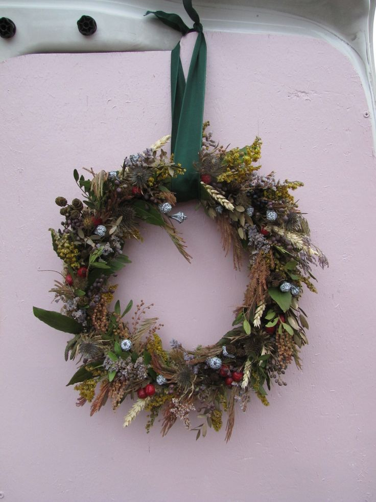 A big colourful wreath, Wheat, Solidago, Rose hips, Eucalyptus, Eryngium, Mimosa and Catkins