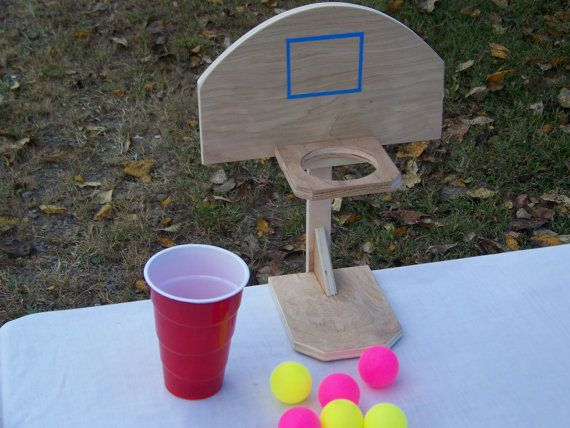 This is a fun game we designed to resemble actual basketball goals and be played as a drinking game, (empty or with liquid inside), or can be used by kids, adults, family and friends at outings, barbecues, kids bedroom, kitchen table, etc. Make your own rules to play however you like. Uses colored ping pong balls so it can be played inside or out, year round. Throw the balls straight in or bounce them in, either way. They also have a hanger on the back to hang on a wall which gives you more…