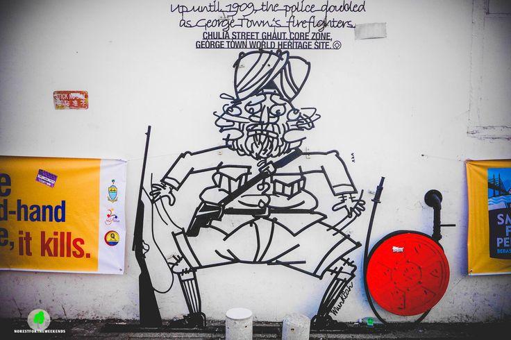 Street Arts: Georgetown, Penang, Malaysia | depicting a Punjabi Man having dual role- as policeman and fireman