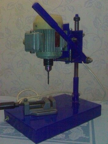 Drill Press by Vitaly -- Homemade drill press constructed from an electric motor, chuck, a pinion gear assembly, steel plate, and a switch. http://www.homemadetools.net/homemade-drill-press-15