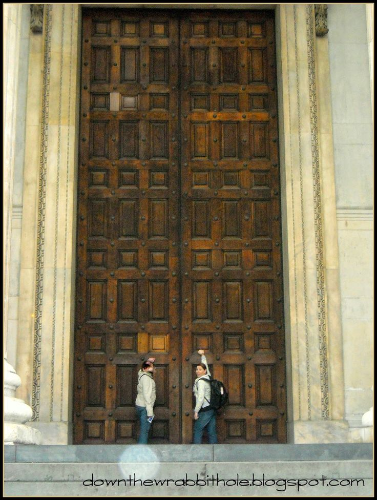 """Knocking on the giant doors of St. Paul's Cathedral during our London bus tour. Find out more at """"Down the Wrabbit Hole - The Travel Bucket List"""". Click the image for the blog post."""