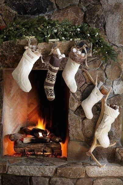 The stone fireplace is beautiful with neutral stockings, but not a fan of the antlers, too rustic for my taste.