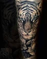 Resultado de imagen para tigres en agua tatto