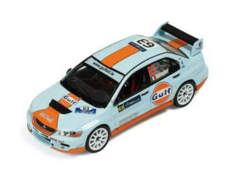 This Mitsubishi Lancer EVO IX (Shaun Gallagher - Rally Ireland 2009) Diecast Model Car is Blue and Orange and features working wheels. It is made by IXO and is 1:43 scale (approx. 10cm / 3.9in long).  ...