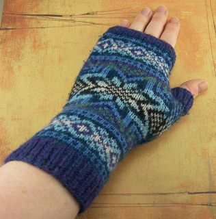 This pattern was the first that I ever wrote and published. The gloves are worked from the cuff upwards with a side gusset for the thumb. The gloves extend higher up on the fingers than most fingerless mitts for extra warmth. There are seven colors in the original project, but I've seen some stunning versions using only two colors.