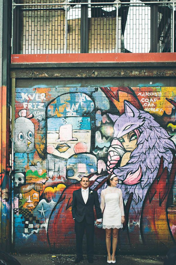 I love the contrast between the couples wedding attire and the graffiti artwork on the wall
