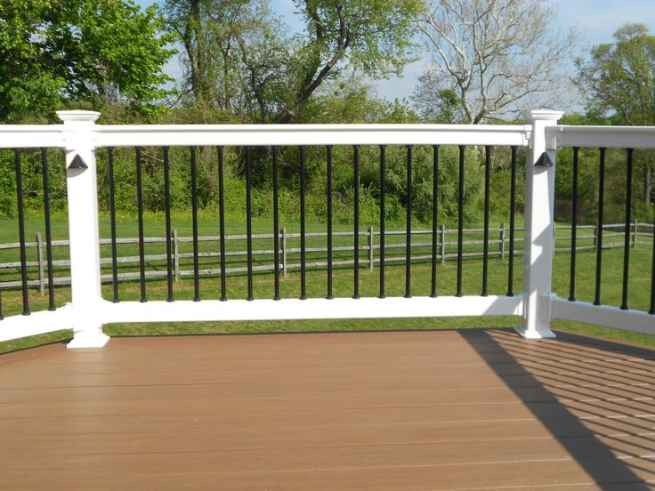 Black and White Deck Railings with Spindles Visit 100s of Deck Railing Ideas http://awoodrailing.com/2014/11/16/100s-of-deck-railing-ideas-designs/