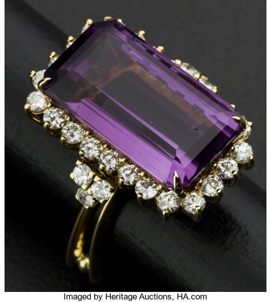 Facetted Amethyst & Diamond 18k Gold Ring. Facetted Amethyst & Diamond 18k Gold Ring 18k yellow Gold, 13.0 grams, facetted Amethyst is 21 mm x 12 mm top to bottom, approximately 1.50 cttw., size 5 1/2, the ring sides are open with two Gold bars, very tiny edge chip on the Amethyst.