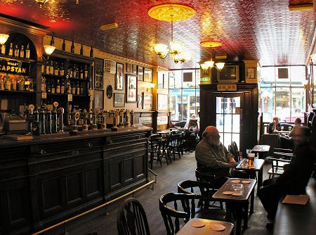 My local pub, The Bow Bar, Victoria Street, Edinburgh. Two minutes from home, great beer, doesn't play music - the perfect place to read for class.