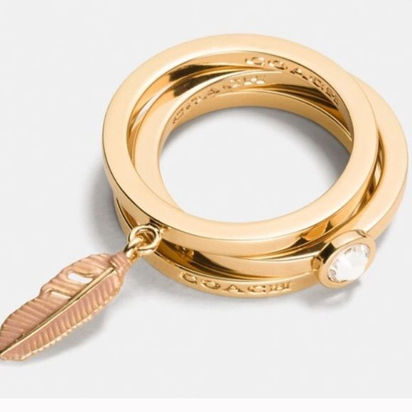 Coach Rings ✨ Three stackable Coach rings- one with a dangle pink feather charm ✨ Coach Jewelry Rings