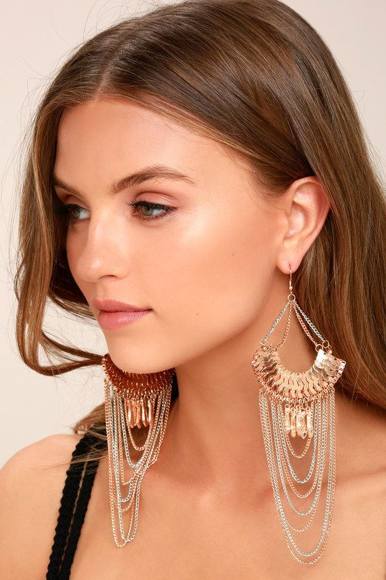 """Make a statement in the Make it Last Silver and Rose Gold Earrings! These stunning earrings feature a focal with rose gold charms, plus 7"""" long silver and rose gold chains."""