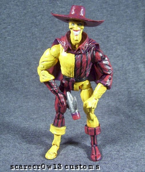 this is a marvel legends Madcap Custom Action Figure he was made by figure realmer scarecrow studios he used a doctor strange body, boot cuffs are from a aoa sabretooth the head is a secret files joker, the cape is a dc universe classics spectreand, the hands are a twin pack wolverine, and the hat was shaved down from a much bigger old sickle strike scarecrow and a madman gun happy pinning