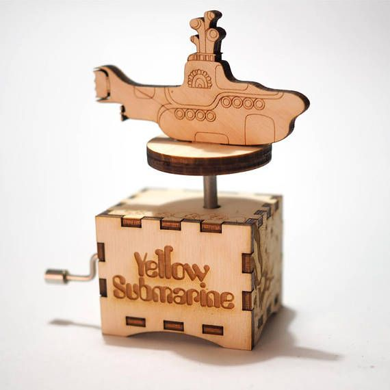"We all live in a Yellow Submarine This is the perfect gift for any Beatles fan. Inspired by the visuals from the Yellow Submarine animation and illustrations, this exclusive music box will not last forever! Get it while it lasts! Laser engraved and cut hand-cranked music box. Material: 3mm Birch Plywood Size: WxHxD: 60x40x60mm (2.36x1.57x2.36"") Tune: The Beatles - Yellow Submarine This original crankshaft mechanism has been placed in a natural wood box that has been designed by Quetzal…"