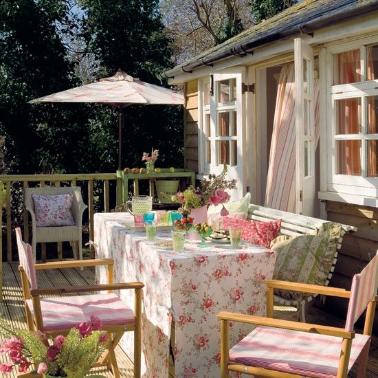 Make space to dine  Provide a summerhouse with a decked area and you've the perfect spot for lazy summer lunches. A mix of striped and floral fabrics and folding directors' chairs dress up the typical English clubhouse look.