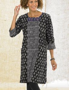 Modified boat neck tunic dress with front patch pocket and center front panel might be one of the prettiest styles of the season. Graphic handblock batik prints in tonal steel and black flatter. Embroidered neckline is sensational. Relaxed fit to wear alone or over pants. 100% cotton.  Made by WARE